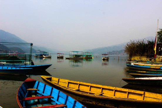 boats along the lakeside in pokhara