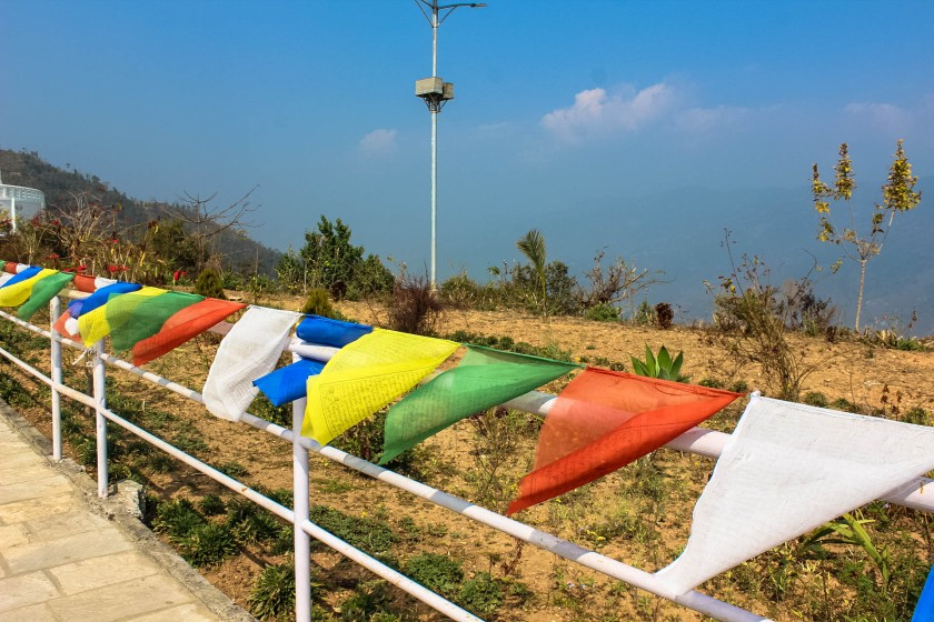 prayer flags at the Shanti Stupa in nepal